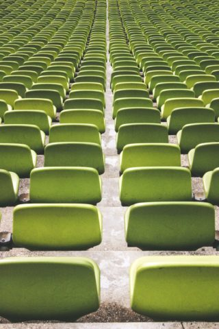 stadium seating filled with green chairs
