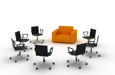 Seven Black office chairs on wheels and one big orange padded chair in a circle