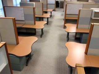 wood and grey cubicles in a large office