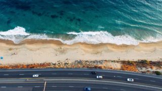 arial shot of orange county beach coastal line, with street
